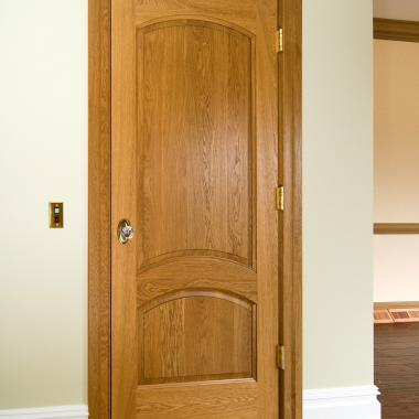TS2050 elevator door in white oak with Roman ogee (OG) sticking and raised (A) panel.
