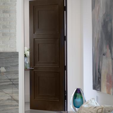 Design a door for each opening by using a mix of paint-grade and stain-grade throughout the home.