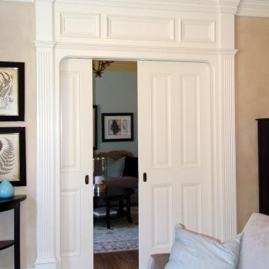 Pair of TS4000 pocket doors in MDF with low profile bolection (LP) moulding and raised (A) panel.