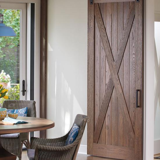 Breakfast nook with rustic barn door