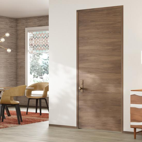 TMF1000 modern flush wood door in walnut with White Haze stain.