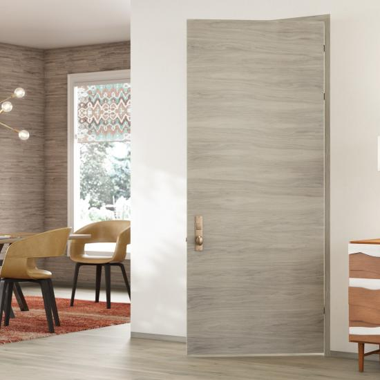 TMF1000 modern flush wood door in walnut with Bleached stain.