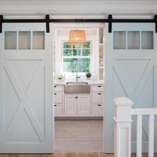 Pair of PL143 barn doors in MDF with clear glass, Square Stick (SS) sticking and custom plant-on accents.