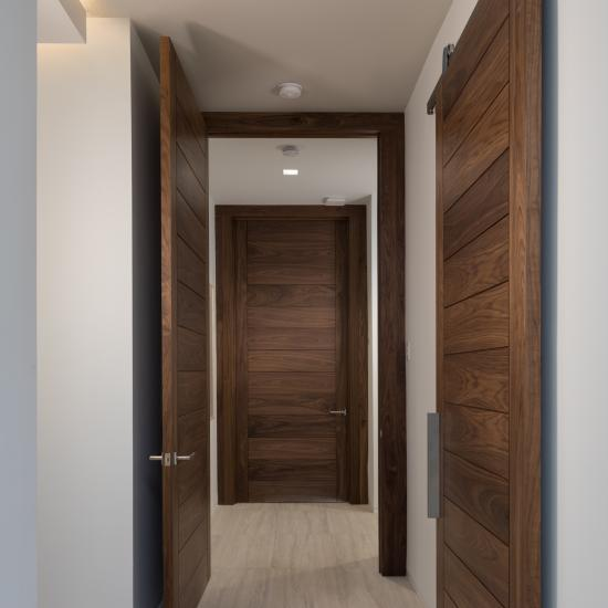 Oversized TM13000 doors make dramatic entrances to each bedroom. They are matched by a TM13000 barn door for the master closet.
