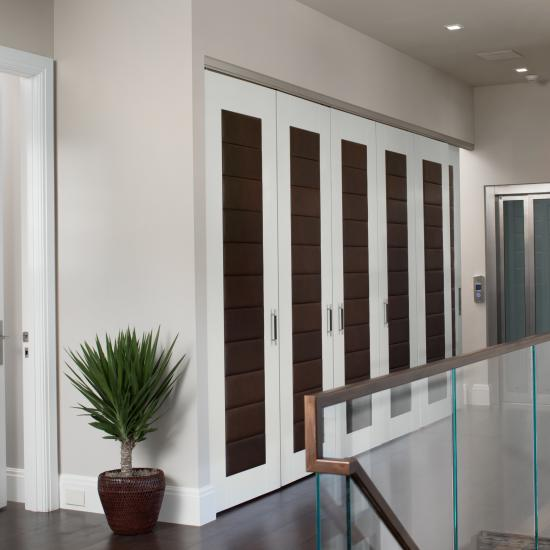TM13170 closet doors in MDF with Sulky Bridle leather. TM13000 in MDF to the left.