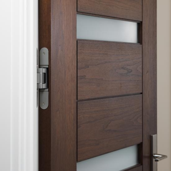 Concealed hinge on TM13340 in walnut with Cappuccino stain and Frosted glass inserts.