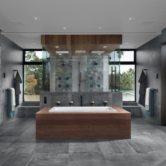 Master bath features TMF1000 flush doors in walnut with Ebony stain.