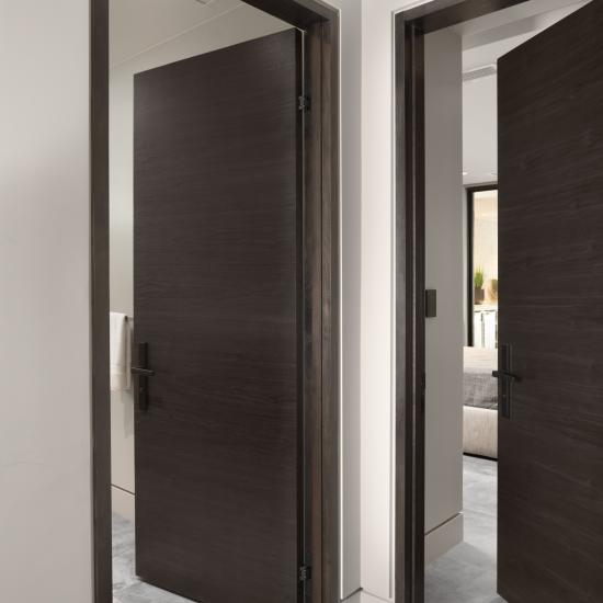 TMF1000 hallway doors in walnut with Ebony stain. Note the kerfed drywall detail around the modern TruStile jambs.