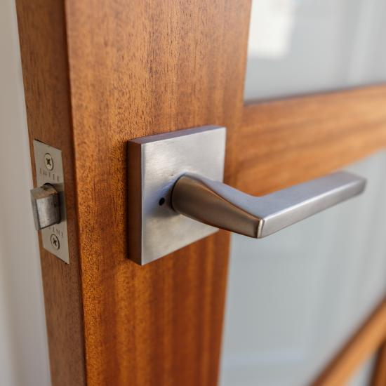 Detail of TS5000 door in mahogany with Square Stick (SS) sticking and White Lami glass.