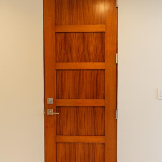 TS5000 house-to-garage fire-rated door in mahogany with Square Stick (SS) sticking and Flat (C) panel.