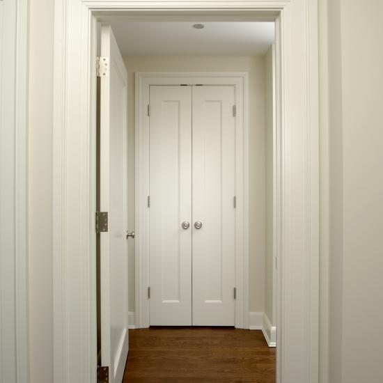 Pair of TS1000 closet doors in MDF with Roman Ogee (OG) sticking and Flat (C) panel.