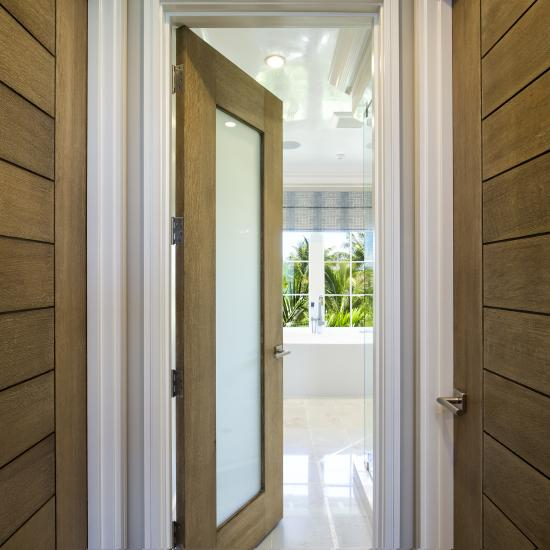 TM13000 and TM1000 hallway doors in white oak with custom ceruse finish and white lami glass