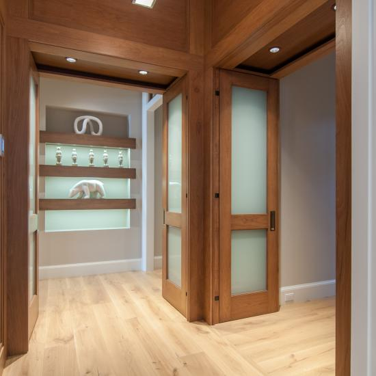 TS2020 bedroom doors in walnut and white lami glass feature harmon hinges.