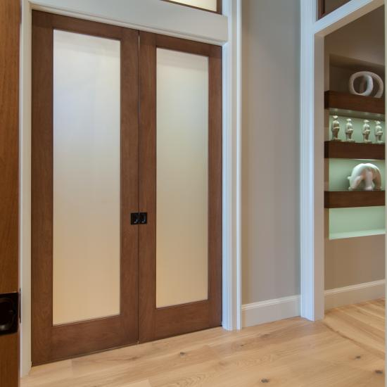 Pair of TS1000 pocket doors in walnut with white lami glass