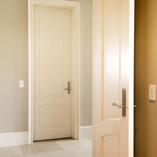 Tall TS2050 doors add a simple elegance to this grand hallway. MDF with quarter round sticking and raised (A) panel.