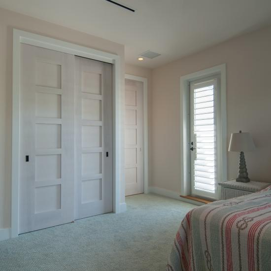 The custom whitewash finish of these birch TM5000 doors ties in with the pastel color scheme of the home.