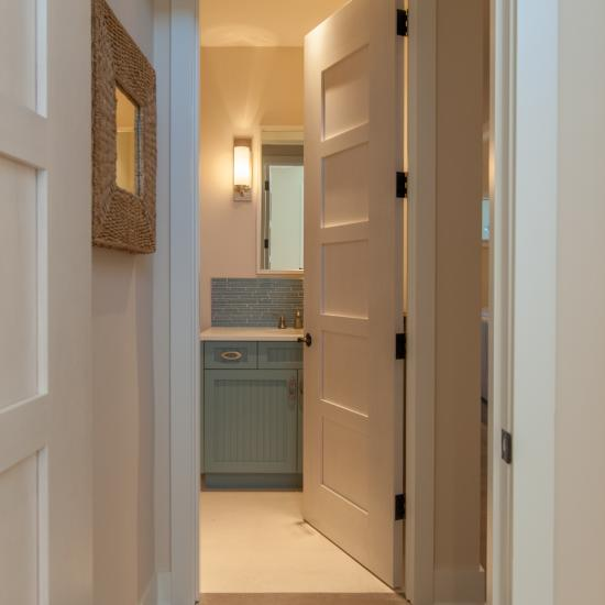 TM5000 birch door features custom whitewash finish to match the pastel color scheme of the home.