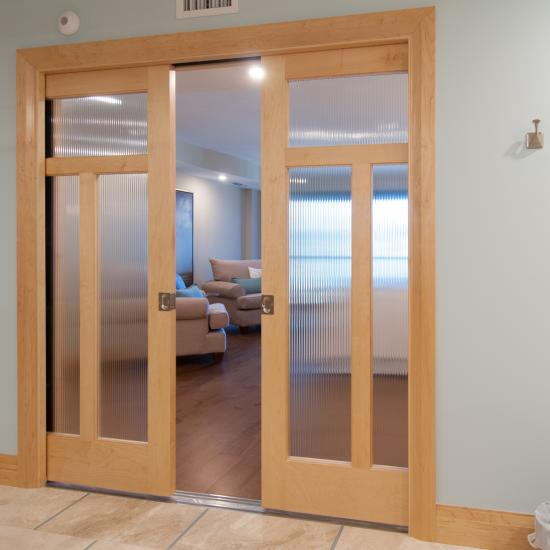 A pair of TS3240 doors in maple and reeded glass