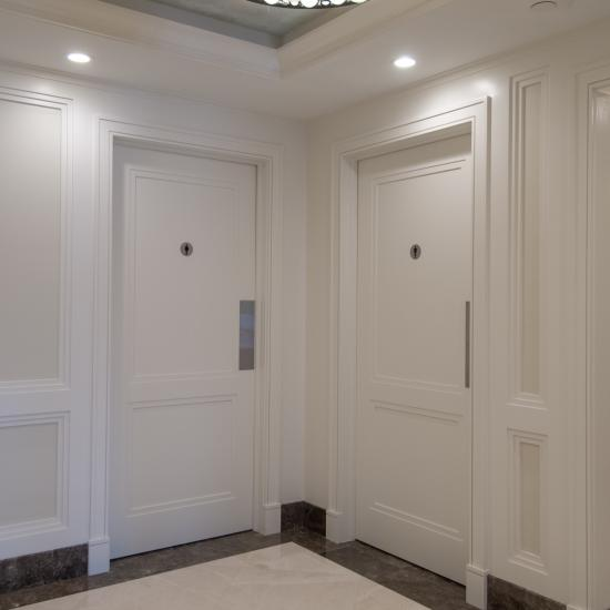 TS2020 restroom doors in MDF feature custom applied moulding
