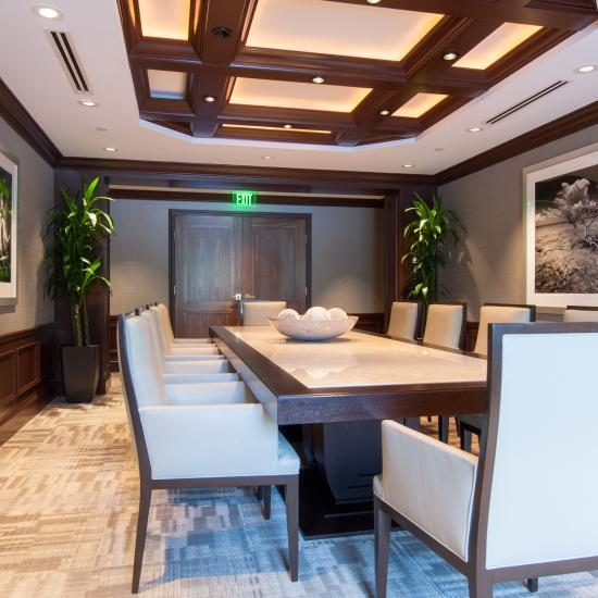 Conference room features TS2020 doors in walnut with custom applied moulding
