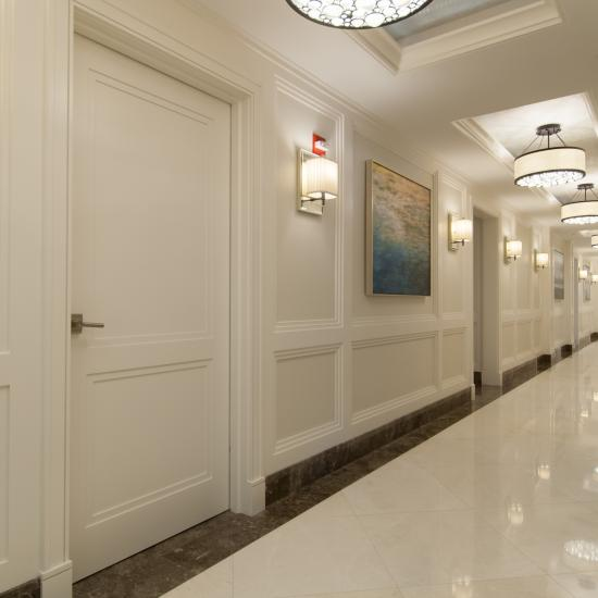 Hallway features TS2020 doors in MDF with custom applied moulding