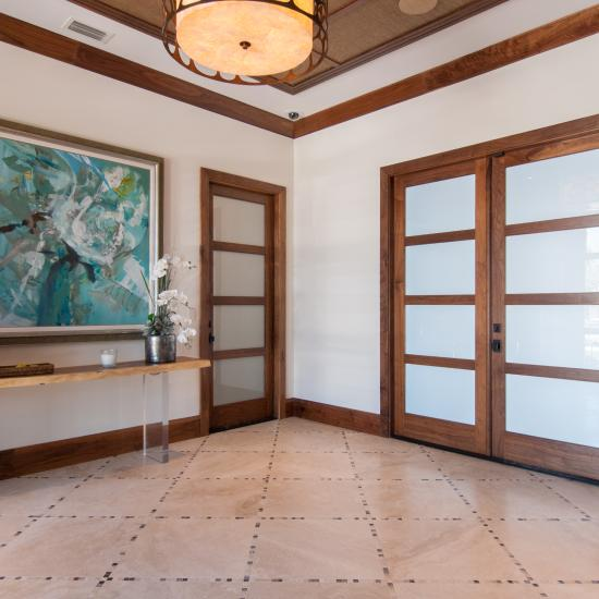Foyer features TS4100 doors in walnut with white lami glass