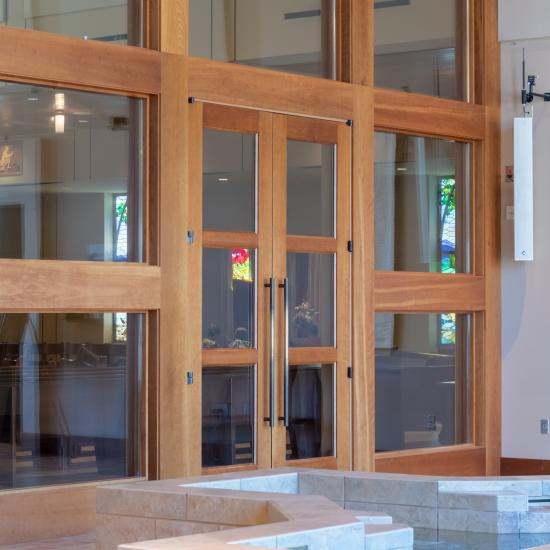 A pair of TS3000 doors in cherry and glass open to the sanctuary