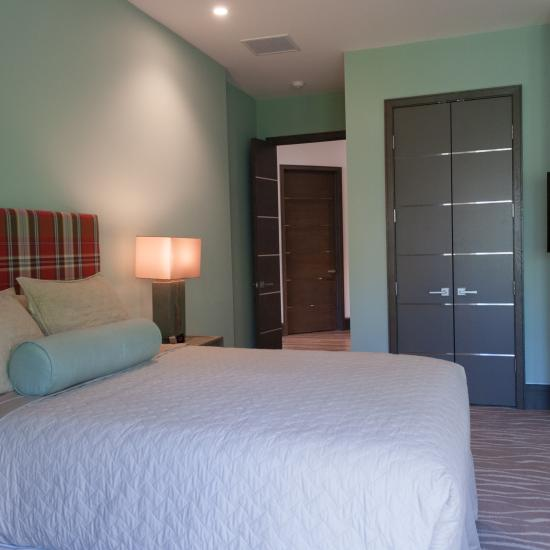 Guest suite featuring TMIR6000 doors in MDF with bright stainless inlay.