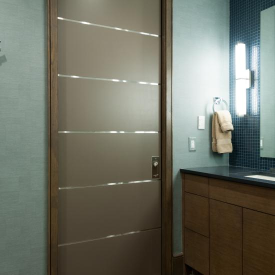 TMIR6000 pocket door in MDF with bright stainless inlay.