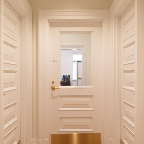 Custom MDF doors with clear glass, Bolection (BM) moulding and Raised (E) panel.
