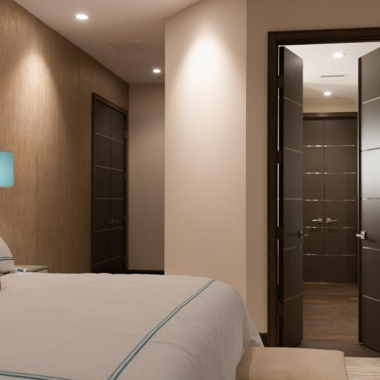 Bedroom suite with TMIR6000 doors in MDF with bright stainless inlay.