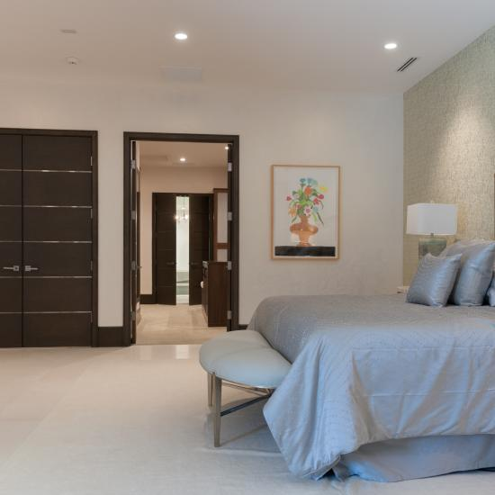 Bedroom suite with TMIR6000 doors in white oak with bright stainless inlay.