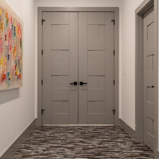 A pair of TM9420 doors in MDF open to the master bedroom.
