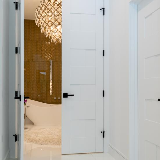 This modern master bath features TM9420 doors in MDF with flat panel inserts.