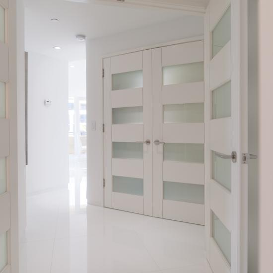 "TM9160 doors in MDF with 1/4"" kerf cut reveal and White Lami glass."