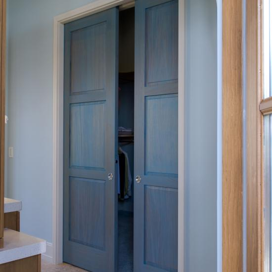 Pair of TS3000 pocket doors in blue-staind mahogany with square stick (SS) sticking and raised (A) panel
