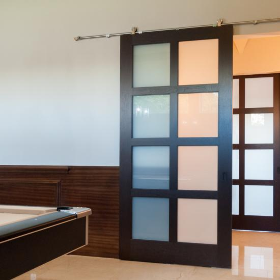 TS8000 barn door in mahogany with Square Stick (SS) sash and White Lami glass.