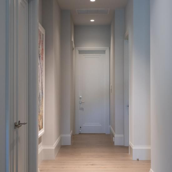 A hallway with TS1000 doors, in MDF with Miracle (MR) moulding and flat (C) panel, leads to the garage.