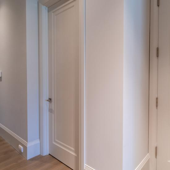 A hallway features TS1000 doors, in MDF with Miracle (MR) moulding and Flat (C) panel.