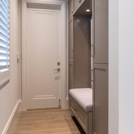 A mudroom features TS1000 doors in MDF with Miracle (MR) moulding and Flat (C) panel.