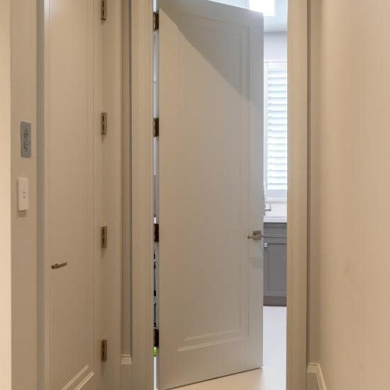 TS1000 doors in MDF with Miracle (MR) moulding and Flat (C) panel are used for both the elevator and laundry room.