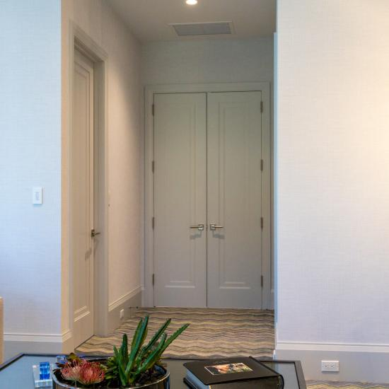A pair of TS1000 doors, in MDF with Miracle (MR) moulding and flat (C) panel, provide privacy for the family room.