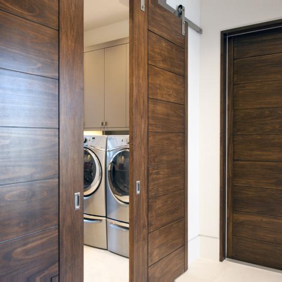zoom Pair of TM9000 sliding barn doors in walnut with asymmetric stiles and kerf cut reveal & Photo Gallery   TruStile Doors Pezcame.Com
