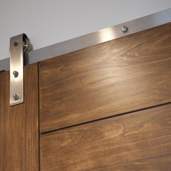 Detail of TM9000 barn door in walnut with asymmetric stiles and kerf cut reveal