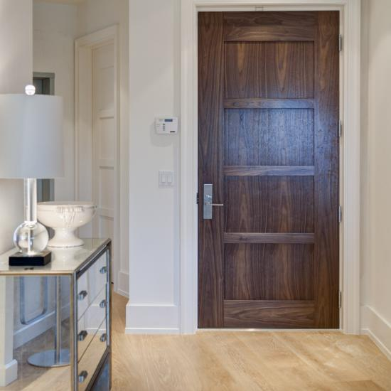 TM4000 entry door with wide stiles in walnut