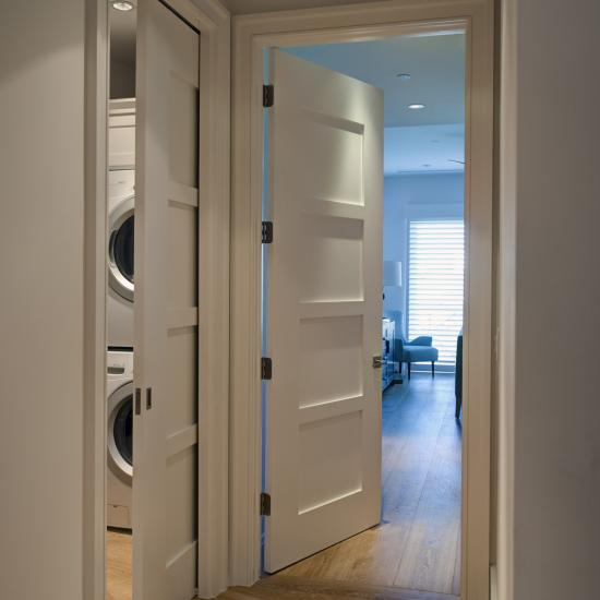 Hallway featuring TM4000 doors with wide stiles in MDF, pocket door on left.