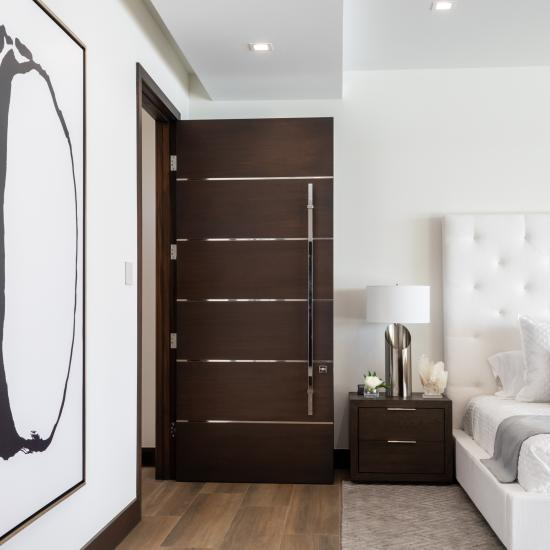 "This master bedroom suite features TMIR6000 doors in mahogany with ½"" bright stainless steel inlay. Builder provided stain finish."