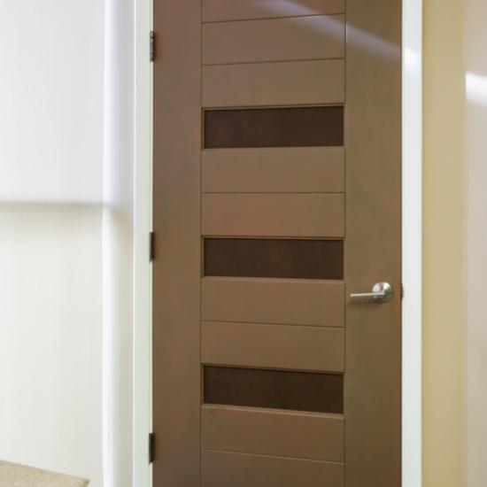 This TM13150 MDF door has been faux finished to look like copper and is inset with Sulky Bridle leather.