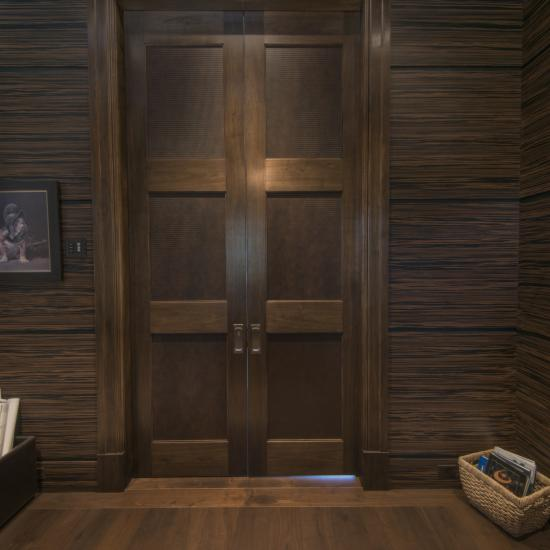 Massive pair of TS3000 pocket doors in walnut with Square Stick (SS) sticking and custom leather panels.