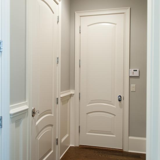 Hallway doors in MDF with Roman ogee (OG) sticking and senior raised (E) panel.